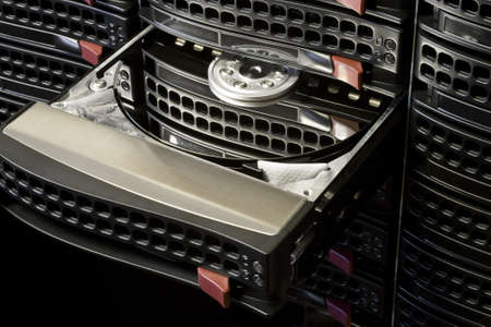 Open Hard Disk Drive in black hot swap frame. Nice reflection on platter.