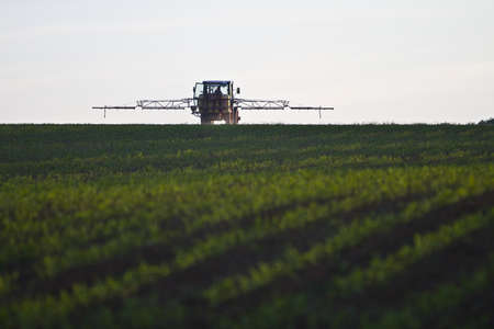 nitrate: tractor with pesticide on field