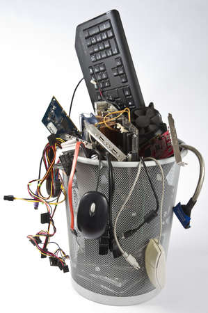 computer part: trashcan in grey background with many computer parts
