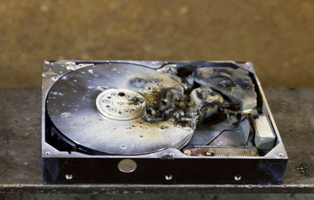 fixed disk: dead hard drive in close up. rusty background Stock Photo