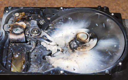 data recovery: melted hard drive in close up view