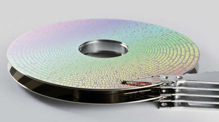 parts of hard disk drive in grey background with symbolized information on magnetic surface photo