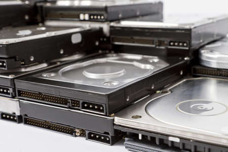 mass storage: stack of hard drives with different connectorns in close up shot