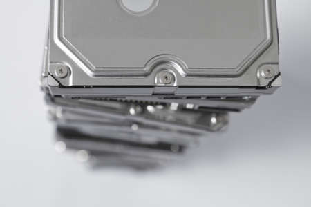 no integrity: stack of hard disk drives with depth of field