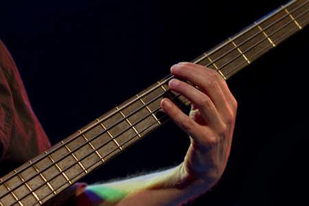 oscillate: men playing guitar. detail shot in black background