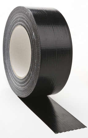 black adhesive tape  on light background. partly unroled photo