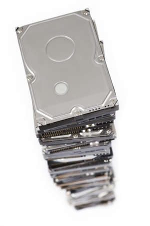 fixed disk: stack of hard drives on white background. Top view with selective focus. Stock Photo