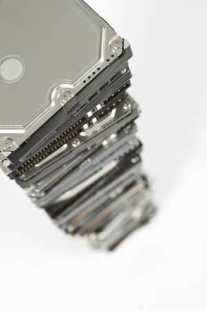 no integrity: stack of hard drives with copy space and selective focus