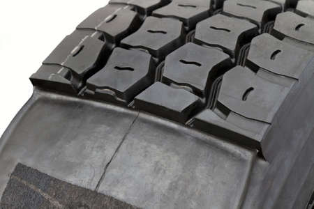 tread pattern: modified tire from a lorry isolated on white. Half with, the other without tread pattern.