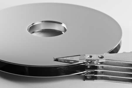 parts of hard drive in close up. read write head and platter