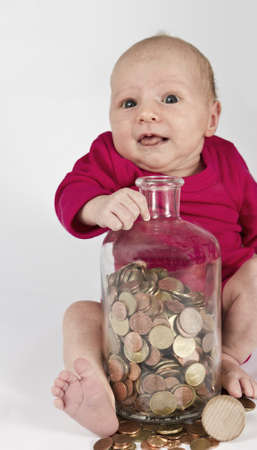 nursling with money in bottle looking at camera photo