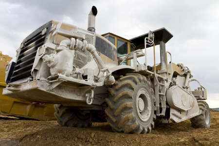 loamy: huge rotary hoe in wide angle view on construction ground