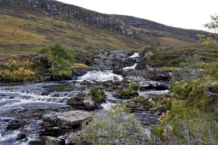 heathland: small river in scottish highlands flowing through heathland