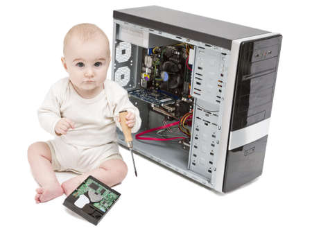 bulk memory: young child with screwdriver in hand working on open computer in white background. hard disk laying around