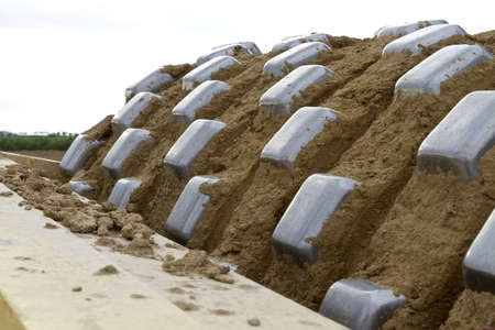 compactor: detail of heavy compactor with soil. horizontal image