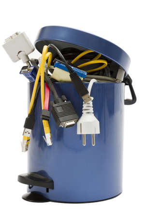 small trashcan with electronic waste on white background photo