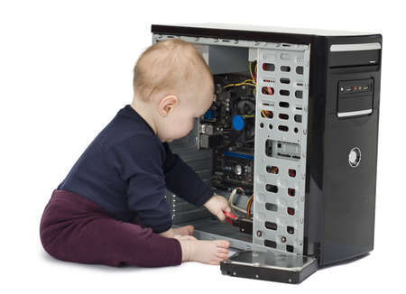 young child in blue shirt with open computer on white background Stock Photo - 11772577