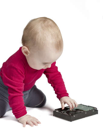 fixed disk: young child in white background with hard drive. red shirt and blue trousers