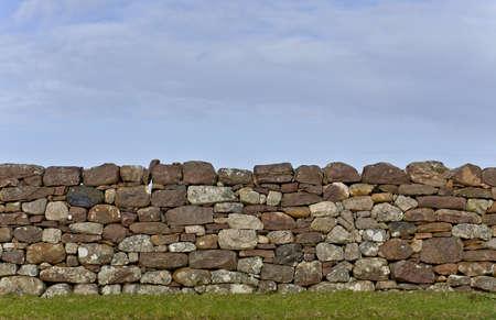 scottish stone wall in evening light. detail shot. vertical image photo
