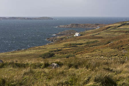 coastal landscape in northern scotland with grass in front Stock Photo - 11772632