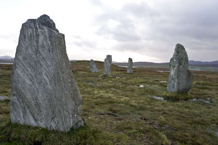 moistness: The Callanish Stones are an ancient monument. dramatic light