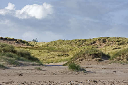 dunes in north scotland with grass and hills in the background Stock Photo - 11772613