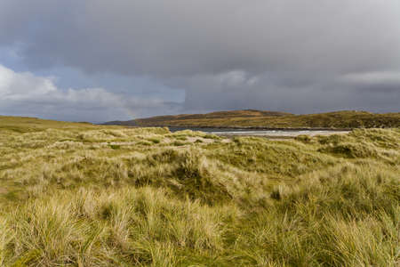 dunes in north scotland with grass and hills in the background Stock Photo - 11772617