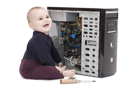 mass storage: young child in blue shirt with open computer on white background