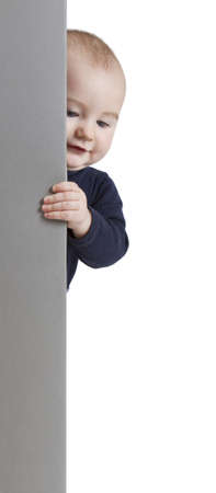 young child holding vertical, grey sign. isolate on white background photo