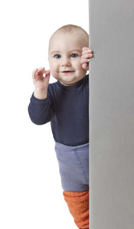 young child holding vertical, grey sign. isolate on white background Stock Photo - 12006385