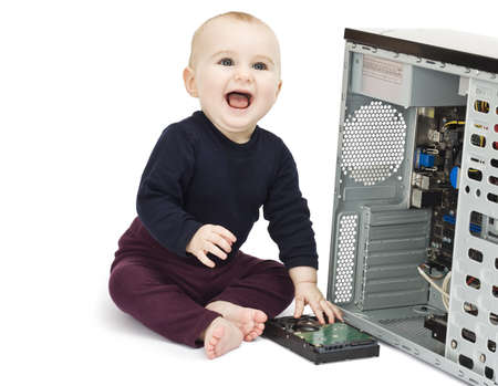 young child in blue shirt with open computer on white background photo