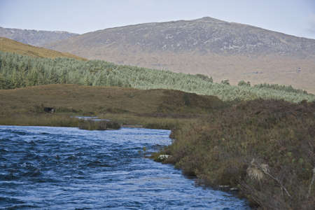 runnel: river in the scottisch highlands with mountain in background