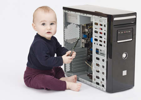 fixed disk: young child in blue shirt with open computer on white background