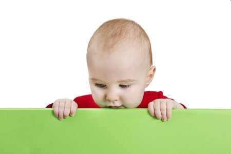 young child presenting green shield. isolate on white background photo