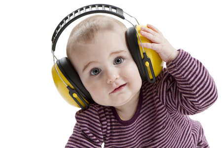protector: young child with yellow ear protector. not amused Stock Photo