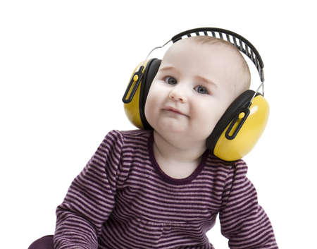 baby with yellow ear protection in loud environment  Isolated on white background Stock Photo
