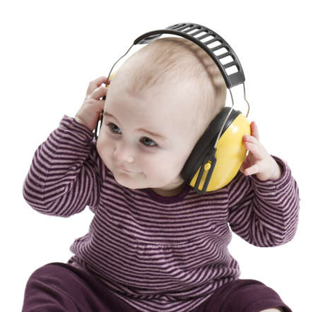 baby with yellow ear protection in loud environment  white background Stock Photo - 12802595