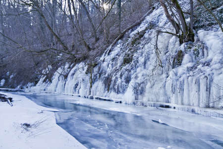 runnel: frozen river with ice  rural scene in south germany