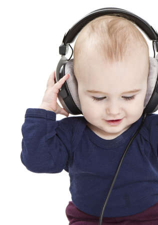young child with earphones listening to music  isolated on white background