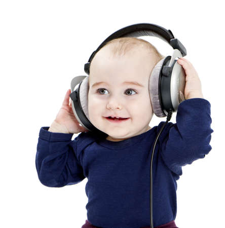 young child with earphones listening to music  isolated on white background Stock Photo - 12932683