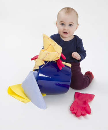floor cloth: toddler with bucket and floor cloth in grey background