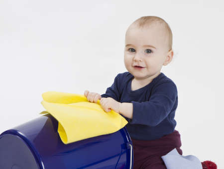 toddler with bucket and floor cloth in grey background photo