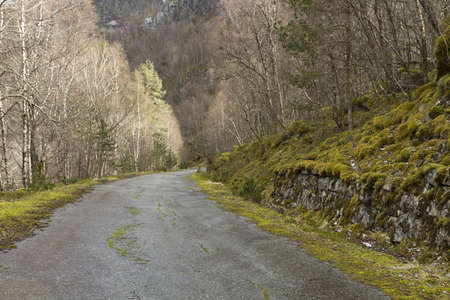 abandoning: unused, run-down road in rural landscape - norway