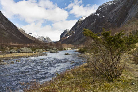 runnel: rural valley with riveron norway - cloudy sky Stock Photo