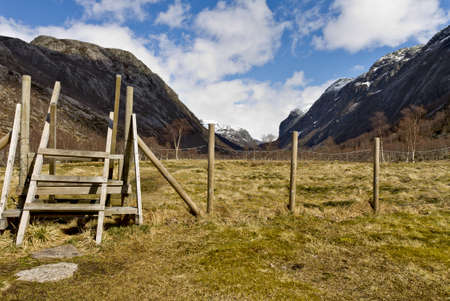 baffle: fence with stairs in rural landscape, norway, europe