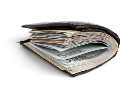 many banknotes in black wallet on light background photo