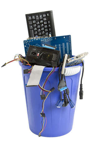 electronic scrap in trash can  keyboard, cables, logicbaord, power supply Stock Photo