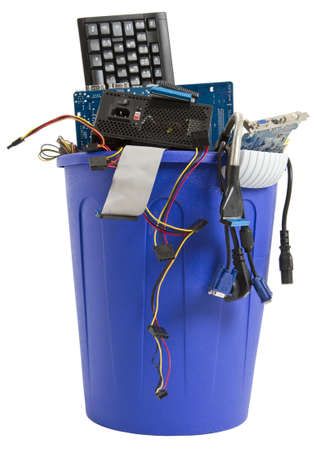 electronic scrap in trash can  keyboard, power supply, cables, logicboard - isolated on white background