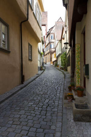 bouldering: narrow lane in historic city in south west germany with bouldering