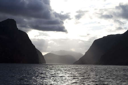 evening view over fjord in norway with cloudy sky and steep coast Stock Photo - 15680233